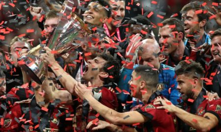 AUFC lifts the cup after defeating the Timbers in the final