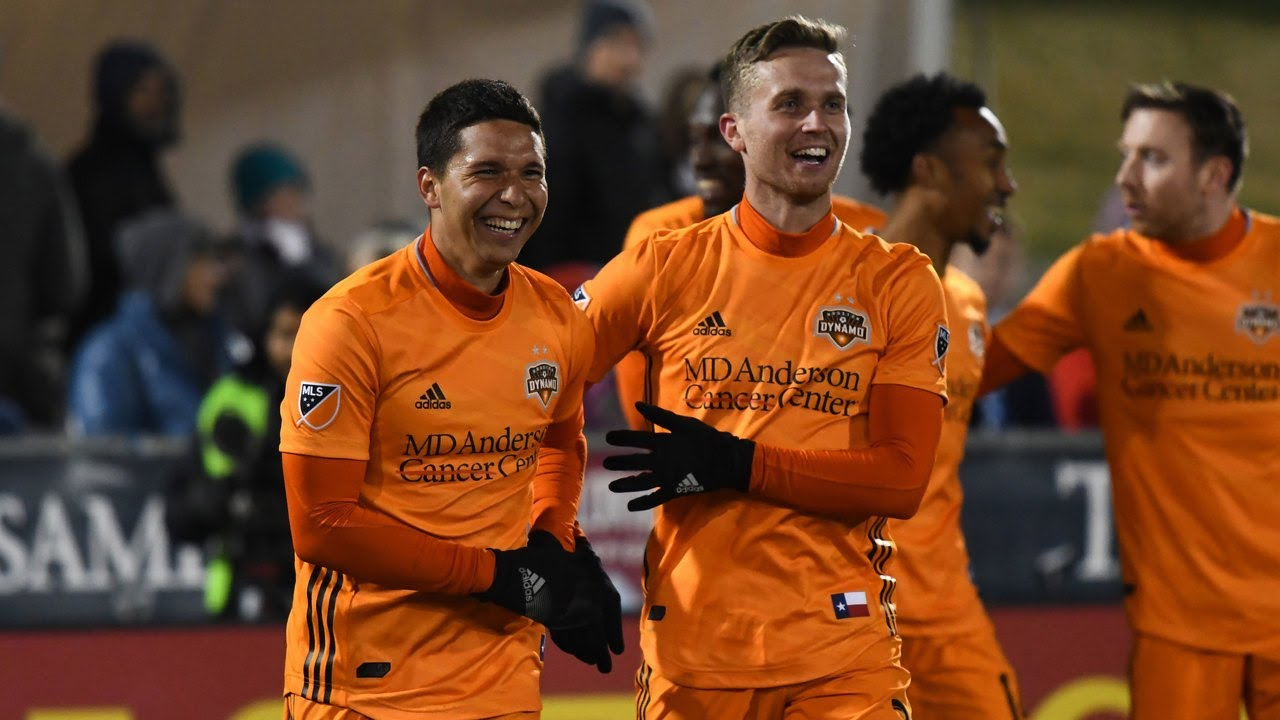 Martinez and Lundqvist of the Dynamo celebrate a goal against the Rapids